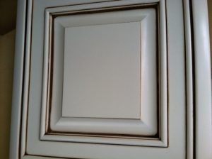 Pinstripped cabinet door.